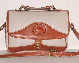 "Is the Vintage Dooney & Bourke ""Bone"" Color More White or Tan?"