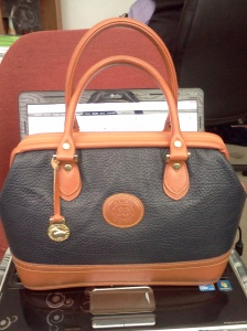 Is an ALBA handbag made by Dooney & Bourke?
