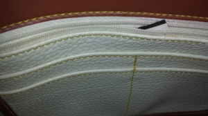 The inside with the zipper and credit card slots