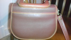 Dooney handbags. Note strap attachment and the way the snap is riveted onto the vinyl strap - never done this way by Dooney and no vinyl straps.